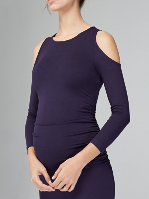 a dress with cut-out shoulders and long sleeves