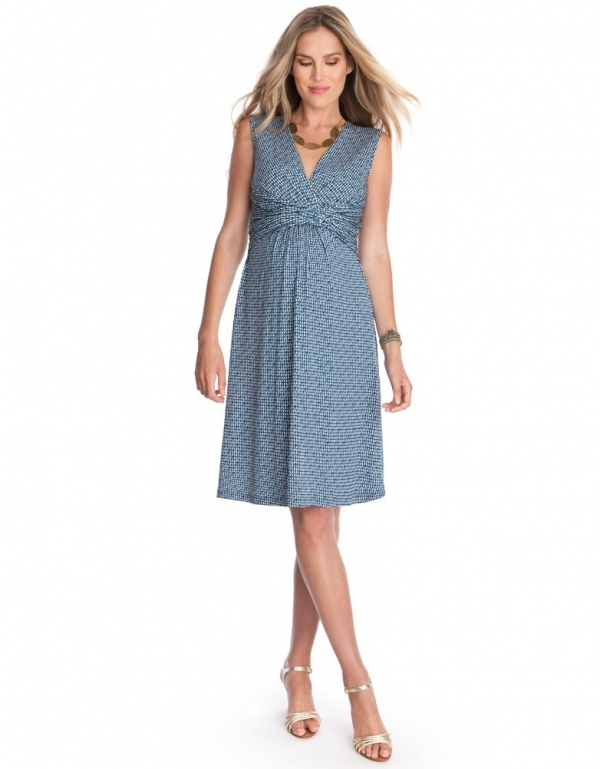 a stylish faux wrap dress with empire waist and sleeveless in blue print